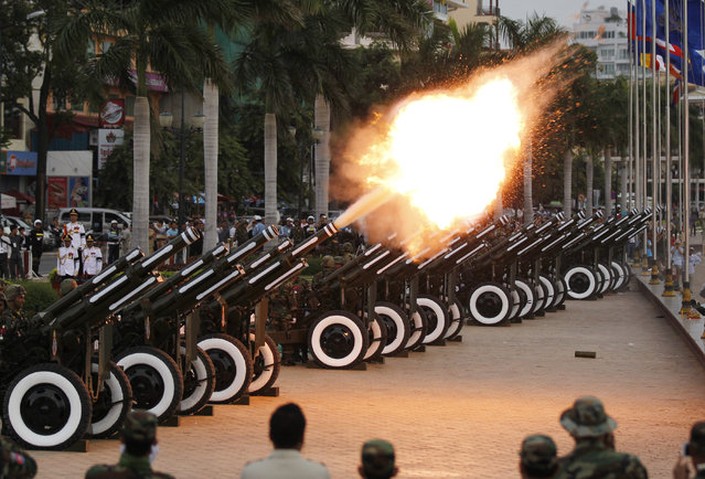 Cambodian military officers fire artillery during a ceremony to pray for former King Norodom Sihanouk at the Royal Palace in Phnom Penh, Cambodia,  July 12, 2014. Cambodians hold the ceremony for moving the ashes of former King Norodom Sihanouk to keep in a stupa at the Silver pagoda in the Royal Palace after he was cremated on February 4, 2013. The monarch died at the age of 89 on October 15, 2012. (Photo by Mak Remissa/EPA)