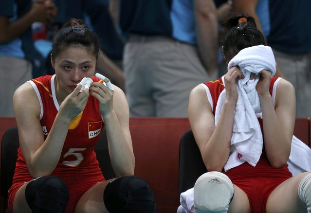 China's Ma Yunwen (L) and Hui Ruoqi react after losing their women's quarterfinal volleyball match against Japan at Earls Court during the London 2012 Olympic Games August 7, 2012. (Photo by Ivan Alvarado/Reuters)