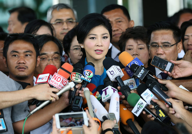 Former Thai prime minister Yingluck Shinawatra (C) speaks to members of the media as she leaves after her trial on criminal charges stemming from her government's rice price subsidy, at the Supreme Court's Criminal Division for Holders of Political Positions in Bangkok, Thailand, 31 August 2015. Yingluck appeared at the court for evidence examination in the rice price subsidy plan case during her government. (Photo by Narong Sangnak/EPA)