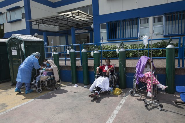 People infected with COVID-19 disease wait for an available bed, outside a public hospital in Lima, Peru, Thursday, April 30, 2020. (Photo by Rodrigo Abd/AP Photo)