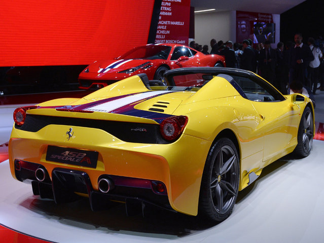 The new Ferrari 458 M is presented at the 2014 Paris Auto Show on October 2, 2014 in Paris, on the first of the two press days. (Photo by Miguel Medina/AFP Photo)