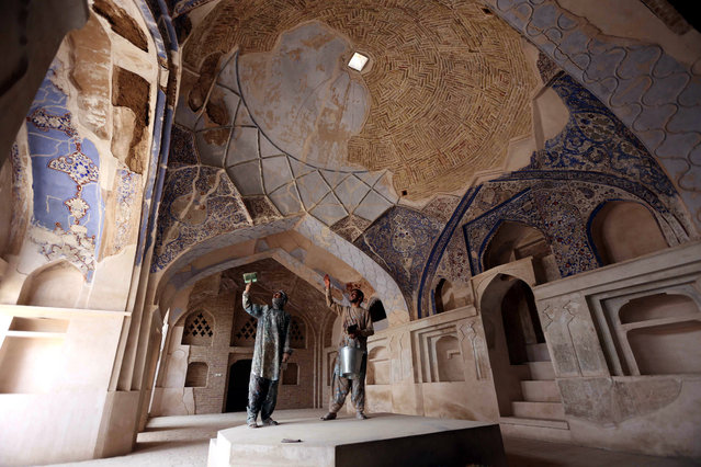 Afghan laborers reconstruct Yu Aw Synagogue, one of four the Jewish synagogues in Herat, Afghanistan, 06 November 2017. The Yu Aw is one of four synagogues in the old quarter of Herat which has now been reconstructed by the Afghan government after decades of abandonment and neglect. (Photo by Jalil Rezayee/EPA/EFE)