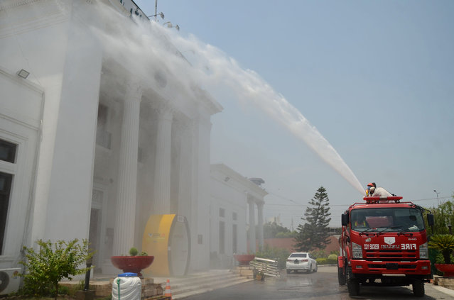 Rescue worker spray disinfectant in Khyber Pakhtunkhwa assembly a preventive measure against the spread of coronavirus ahead of the Presentation of Annual Budget for the Financial Year 2020-21. (Photo by Hussain Ali/Pacific Press/Rex Features/Shutterstock)