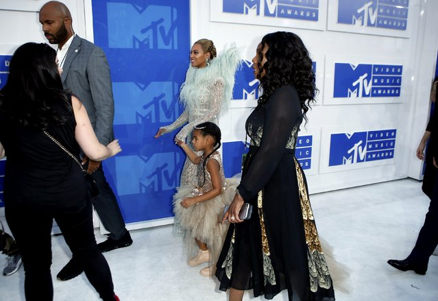 Singer Beyonce, with daughter Blue Ivy, arrive at the 2016 MTV Video Music Awards in New York, U.S., August 28, 2016. (Photo by Eduardo Munoz/Reuters)