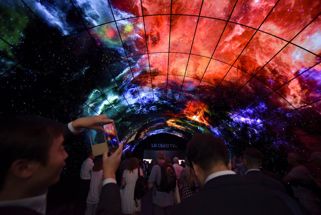 Visitors look at screens at the IFA Electronics show in Berlin, Germany September 2, 2016. (Photo by Stefanie Loos/Reuters)