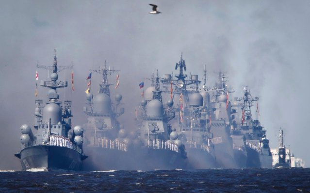 Warships process during the Navy Day parade in Kronstadt, outside St.Petersburg, Russia, Sunday, July 26, 2020. (Photo by Anton Vaganov/AP Photo/Pool)