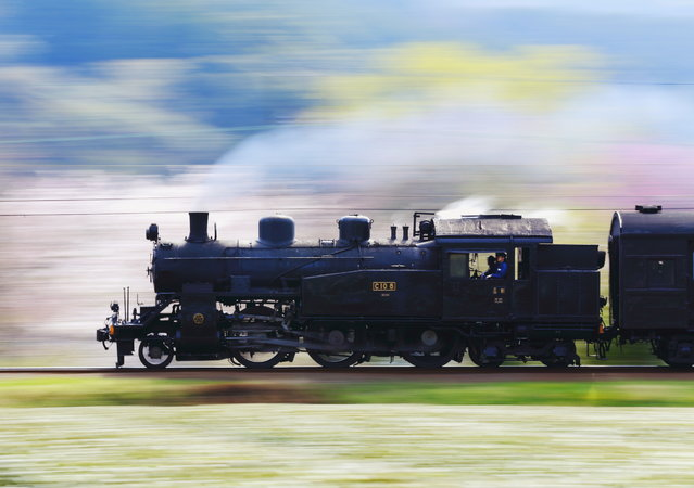 """Spring breeze"". It is a steam locomotive which runs feel full the breeze of spring. Order to express the dash feeling, I got off the shutter to match the speed of the railway running. Photo location: Oigawa railway, Shizuoka, Japan. (Photo and caption by Hideyuki Katagiri/National Geographic Photo Contest)"