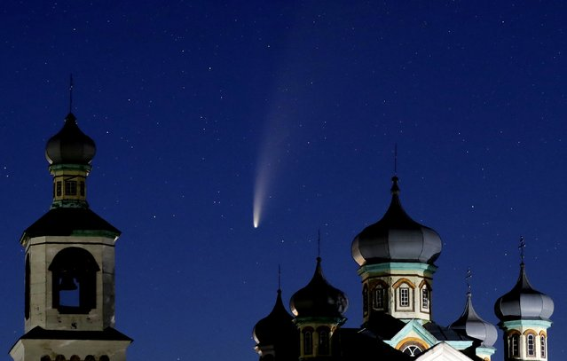 The comet Neowise or C/2020 F3 is seen behind an Orthodox church over the Turets, Belarus, 110 kilometers (69 miles) west of capital Minsk, early Tuesday, July 14, 2020. (Photo by Sergei Grits/AP Photo)
