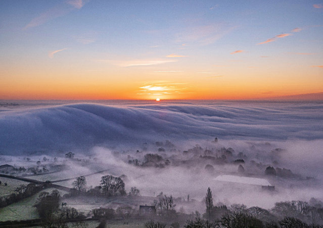 Mist rolls across Glastonbury in Somerset, England  as Brits woke up to a frosty morning on Sunday, January 19, 2020. (Photo by South West News Service)