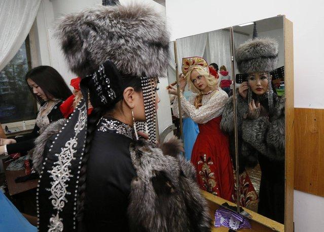 Oyuna Batuyeva (R), 23, of Buryatia and Anna Schelukhina, 20, of Krasnoyarsk Region, prepare backstage before the final show of the 8th Miss Asia-Siberia international amateur beauty and talents contest in Krasnoyarsk, November 9, 2014. (Photo by Ilya Naymushin/Reuters)