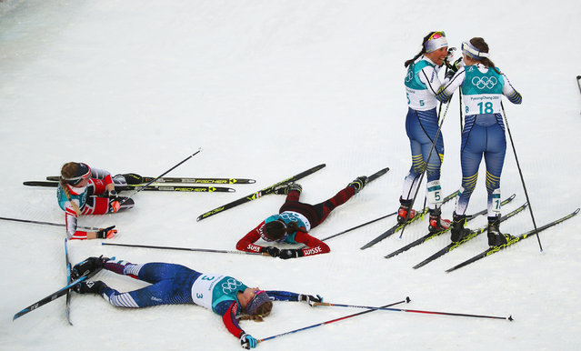 Sweden' s Charlotte Kalla  and her compatriot Sweden' s Ebba Andersson laugh together at the end of the women' s 7.5 km + 7.5 km cross- country skiathlon event at the Alpensia cross country ski centre during the Pyeongchang 2018 Winter Olympic Games on February 10, 2018 in Pyeongchang. (Photo by Carlos Barria/Reuters)