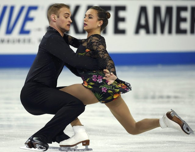 Jessica Pfund and Joshua Santillan of the U.S. perform during the Pairs short program at the Skate America figure skating competition in Milwaukee, Wisconsin October 23, 2015. Fifty-six Olympic and world championship athletes are competing in the event, which is the first of six stops on the International Skating Union (ISU) Grand Prix of Figure Skating Series. (Photo by Lucy Nicholson/Reuters)