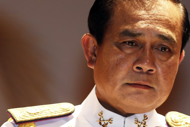 Thai Army chief General Prayuth Chan-ocha pauses as he addresses reporters at the Royal Thai Army Headquarters in Bangkok, in this May 26, 2014 file photo. (Photo by Damir Sagolj/Reuters)