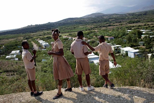 Deaf pupils of the Mission de L'Espoir school take a break between classes in Leveque, Haiti, April 11, 2016. (Photo by Andres Martinez Casares/Reuters)