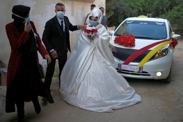 Palestinian groom Tariq Zaanin, 35, walks with his bride on their wedding day amid the coronavirus disease (COVID-19) outbreak, in the northern Gaza Strip on September 22, 2020. (Photo by Suhaib Salem/Reuters)