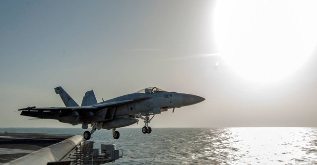 In this image released by the U.S. Navy on Friday, December 5, 2014, a fighter jet launches from the flight deck of the Nimitz-class aircraft carrier USS Carl Vinson (CVN 70) as the ship conducts flight operations in the U.S. 5th Fleet area of operations supporting Operation Inherent Resolve targeting Islamic State militants in Iraq and Syria. (Photo by Mass Communication Specialist 2nd Class John Philip Wagner Jr./AP Photo/U.S. Navy)