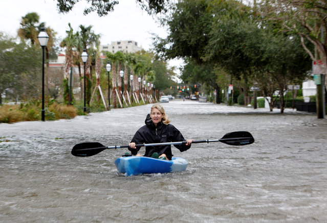 A Charleston resident kayaks down a flooded Rutledge Avenue after Hurricane Matthew hit Charleston, South Carolina October 8, 2016. (Photo by Jonathan Drake/Reuters)