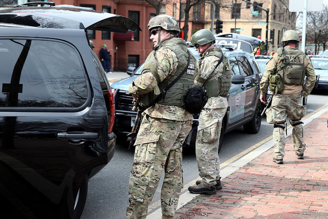 State police guard an area near Kenmore Square after two bombs exploded during the 117th Boston Marathon on April 15, 2013 in Boston, Massachusetts. (Photo by Alex Trautwigs)
