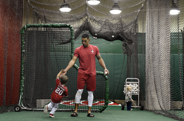 Washington Nationals short stop Ian Desmond high fives his son Grayson, 3, while playing in the batting cages at Nationals Park after a game against the San Diego Padres on Saturday, April 26, 2014. (Photo by Toni L. Sandys/The Washington Post)