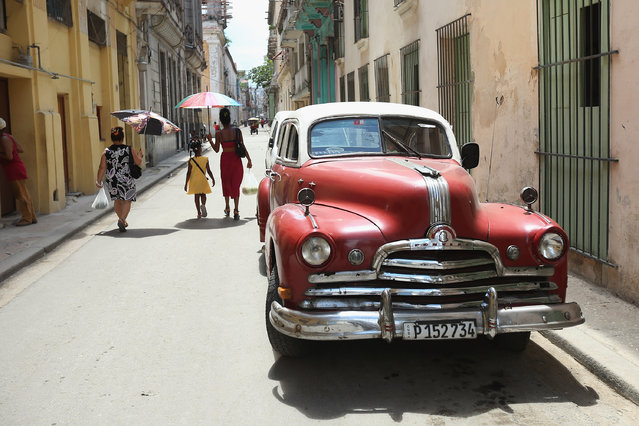 An antique American-made automobile is parked in the old part of the city August 14, 2015 in Havana, Cuba. The first American secretary of state to visit Cuba since 1945, Secretary of State John Kerry visited the reopened U.S. Embassy in Havana, a symbolic act after the the two former Cold War enemies reestablished diplomatic relations in July. (Photo by Chip Somodevilla/Getty Images)