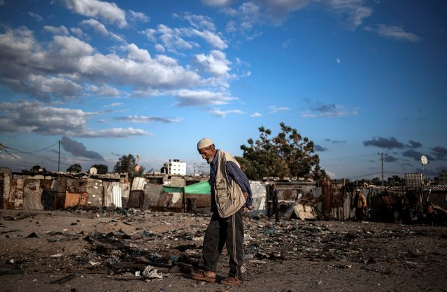 A Palestinian elderly man walks in a slum on the outskirts of Khan Younis Refugee Camp, in the southern Gaza Strip, Wednesday, November 25, 2020. Israel's blockade of the Hamas-ruled Gaza Strip has cost the seaside territory as much as $16.7 billion in economic losses and caused its poverty and unemployment rates to skyrocket, a U.N. report said Wednesday, as it called on Israel to lift the 13-year closure. (Photo by Khalil Hamra/AP Photo)