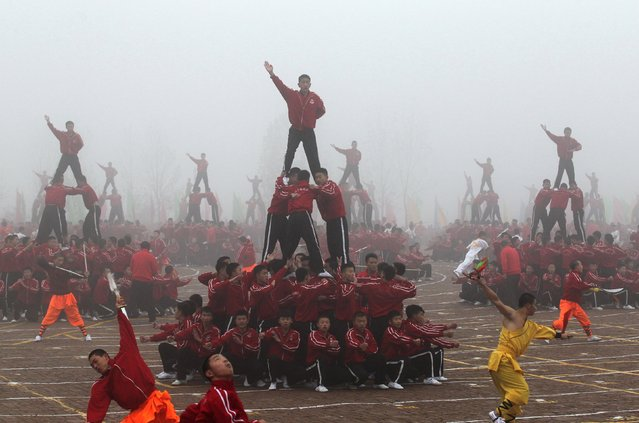 Students perform during a founding ceremony of a football team of Shaolin Tagou martial arts school, in Dengfeng, Henan province, November 10, 2015. (Photo by Reuters/China Daily)