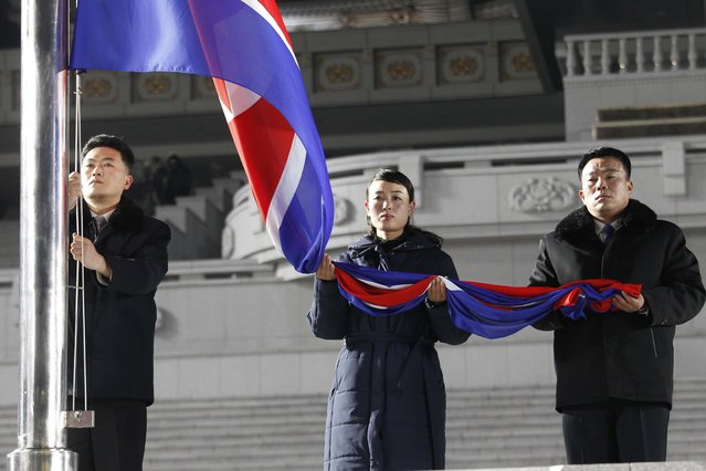 Exemplary workers during the national flag-hoisting ceremony during celebrations for the New Year, at Kim Il Sung Square in Pyongyang, North Korea, early Friday, January 1, 2021. (Photo by Jon Chol Jin/AP Photo)