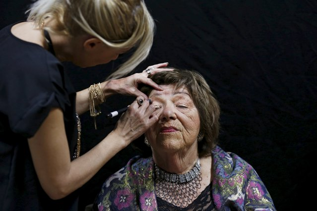 Stela Krashes, 85, (L) a Holocaust survivor, has her make-up done during preparations ahead of a beauty contest for survivors of the Nazi genocide in the northern Israeli city of Haifa, November 24, 2015. (Photo by Amir Cohen/Reuters)