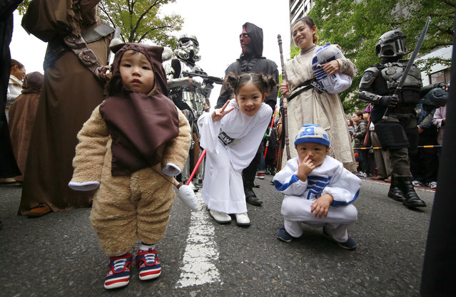 Star Wars fans dressed in costumes of Star Wars characters wait for the start of a Halloween parade in Kawasaki, near Tokyo, Sunday, October 30, 2016. (Photo by Shizuo Kambayashi/AP Photo)