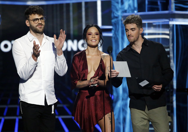 (L-R) Recording artists Alex Pall of The Chainsmokers, Halsey, and Andrew Taggart of The Chainsmokers speak onstage during the 2018 Billboard Music Awards at MGM Grand Garden Arena on May 20, 2018 in Las Vegas, Nevada. (Photo by Mario Anzuoni/Reuters)