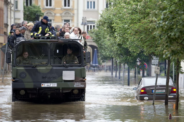 Residents of flooded areas in Gera, eastern Germany are evacuated on June 3, 2013. Parts of the eastern and southern Germany were flooded due to heavy and ongoing rainfalls. (Photo by Marc Tirl/AFP Photo)