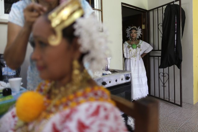 "A woman wearing traditional clothing known as ""Pollera"" stands as she waits to take part in the annual Thousand Polleras parade in Las Tablas, in the province of Los Santos January 10, 2015. (Photo by Carlos Jasso/Reuters)"