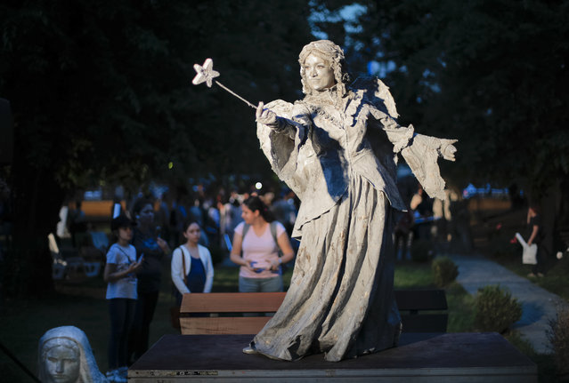 In this Tuesday, May 22, 2018, photograph, an artist of The Netherlands' Levend Theater performs the Angel character during the Living Statues International Festival, in Bucharest, Romania. (Photo by Vadim Ghirda/AP Photo)