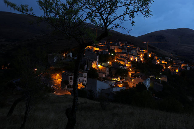 The town of Santo Stefano di Sessanio is pictured at dusk, in the province of L'Aquila in Abruzzo, inside the national park of the Gran Sasso e Monti della Laga, Italy, September 5, 2016. (Photo by Siegfried Modola/Reuters)