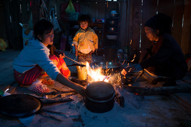 """""""The life in Pulang"""". Pulang women was cooking dinner for the whole family. In Pulang,such an ancient society, women are in charge of all the household duties. Location: Xishuangbanna, Yunnan, China. (Photo and caption by Tianze Jiang/National Geographic Traveler Photo Contest)"""