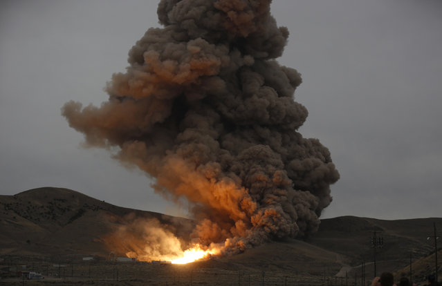 The SLS five-segment Solid Rocket Motor undergoes a static test fire at the Orbital ATK facility in Promontory, Utah, March 11, 2015. A beefed-up space shuttle solid rocket motor passed a two-minute test firing in Utah, a key milestone toward the debut flight of NASA's deep-space launcher in 2018, the U.S. space agency said. (Photo by Jim Urquhart/Reuters)