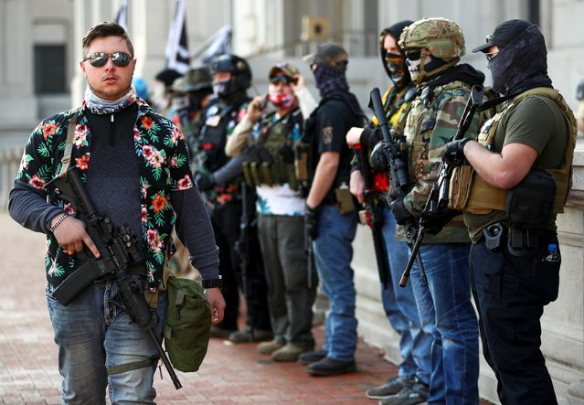 Protest leader Mike Dunn and other armed demonstrators take part in a pro-gun rally in Richmond, Virginia, U.S. November 21, 2020. (Photo by Hannah McKay/Reuters)