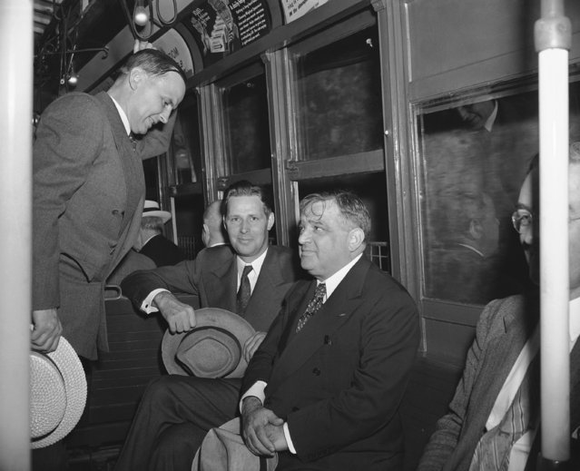 Mayor John F. Carr of Medford, Mass., Mayor Maurice J. Tobin of Boston, and Mayor Fiorello La Guardia of New York, left to right, take a subway to go from City Hall to their hotel for lunch in New York, August 5, 1942, after conferring with mayors of Atlantic Coast cities on gasoline and fuel problems for the northeast. (Photo by AP Photo/Abe Fox)