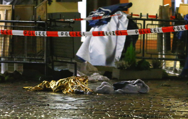Evidence lies at the scene of an incident in Trier, Germany, Tuesday, December 1, 2020. German police say people have been killed and several others injured in the southwestern German city of Trier when a car drove into a pedestrian zone. Trier police tweeted that the driver had been arrested and the vehicle impounded. (Photo by Michael Probst/AP Photo)