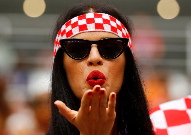 A Croatia fan blows a kiss as she poses for a photo before the Russia 2018 World Cup final football match between France and Croatia at the Luzhniki Stadium in Moscow on July 15, 2018. (Photo by Kai Pfaffenbach/Reuters)