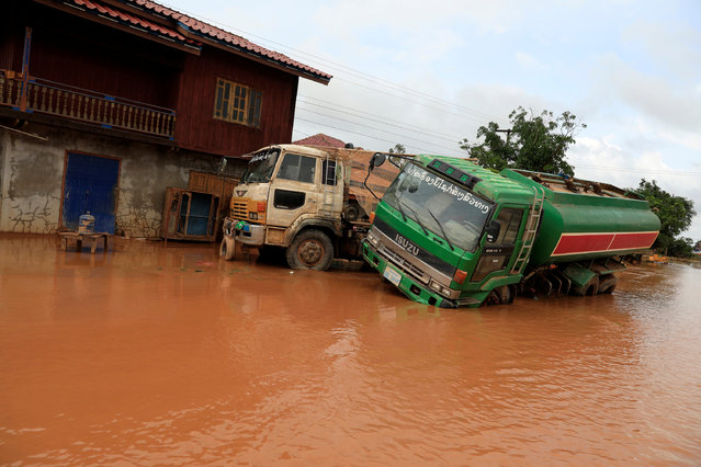 Damaged car is seen during the flood after the Xepian-Xe Nam Noy hydropower dam collapsed in Attapeu province, Laos on July 26, 2018. (Photo by Soe Zeya Tun/Reuters)