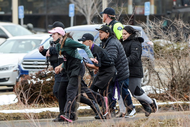 King Soopers employees are led away from an active shooter at the King Soopers grocery store in Boulder, Colorado, U.S. March 22. 2021. (Photo by Michael Ciaglo/USA Today Network via Reuters)