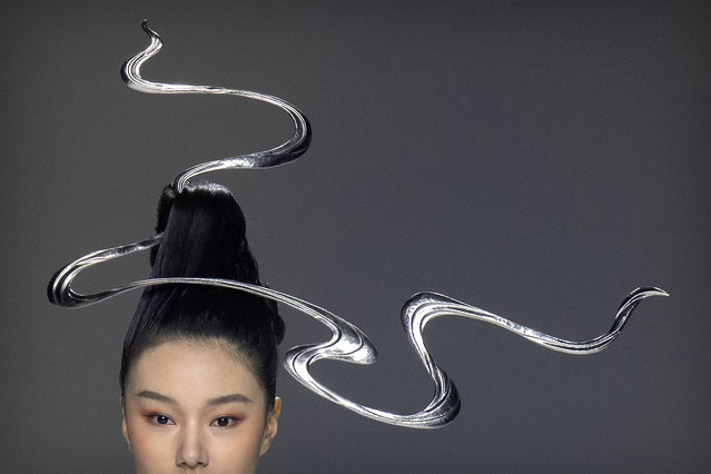 A model presents a creation inspired by traditional Chinese clothing from fashion brand Chuyan during China Fashion Week in Beijing, Saturday, March 27, 2021. (Photo by Mark Schiefelbein/AP Photo)
