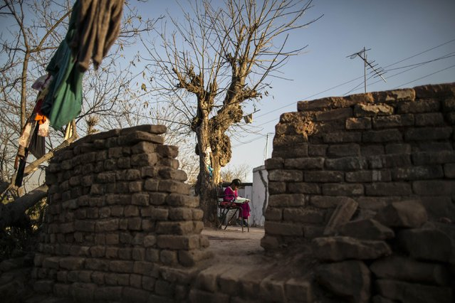 A girl studies at her house on the outskirts of Islamabad February 11, 2015. (Photo by Zohra Bensemra/Reuters)