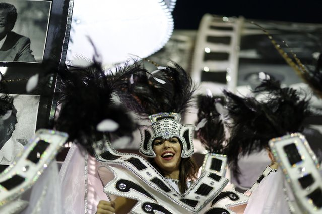 A reveller from the Academicos de Santa Cruz samba school takes part in the Group A category of the annual Carnival parade in Rio de Janeiro's Sambadrome, February 14, 2015. (Photo by Pilar Olivares/Reuters)