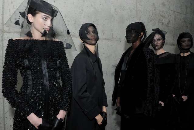Models pose for photographs before the Thom Browne Fall 2015 collection is shown during New York Fashion Week, Monday, February 16, 2015. (Photo by Diane Bondareff/AP Photo)