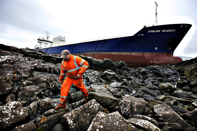 A general view of the container ship Lysblink Seaways grounded at Kilchoan, West Ardnamurchan in the West Highlands, on February 18, 2015. (Photo by Andrew Milligan/PA Wire)