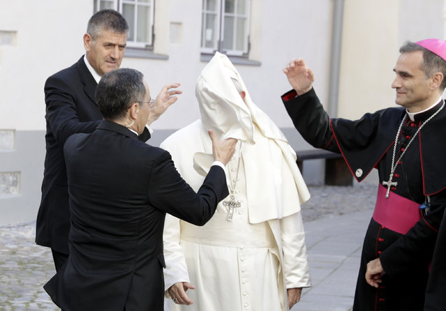 A gust of wind blows Pope Francis' mantle as he arrives to a meeting with people assisted by the church in the Cathedral of Saints Peter and Paul in Tallinn, Estonia, Tuesday, September 25, 2018. Pope Francis concludes his four-day tour of the Baltics visiting Estonia. (Photo by Andrew Medichini/AP Photo)