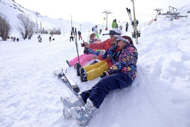 Iranian women take a selfie at the Dizin ski resort, northwest of Tehran January 15, 2016. (Photo by Raheb Homavandi/Reuters/TIMA)