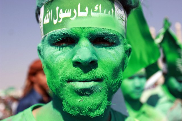 A Muslim Yemeni shows of his coloured face during a gathering marking the birth anniversary of Islam's Prophet Mohammed on December 11, 2016 in the Yemeni capital Sanaa. (Photo by Abdel Rahman Abdallah/AFP Photo)